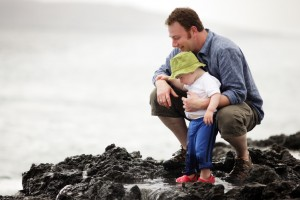 Dad with little son outdoors at ocean