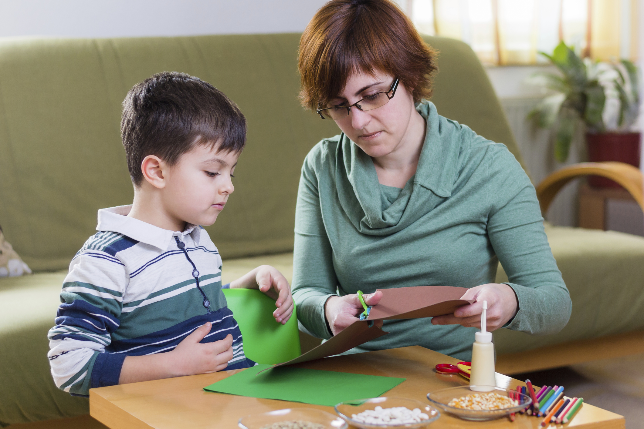 Mother and son crafting