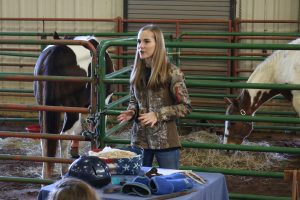 Lindsey Langford, a 10-year participant in the 4-H Horse Club, talks to students about caring for her two horses.