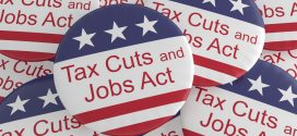 Tax Cuts and Jobs Act buttons in a pile. Image by shutterstock.com/cbies.
