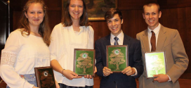 Lee County 4-H members holding National Forestry Invitational awards